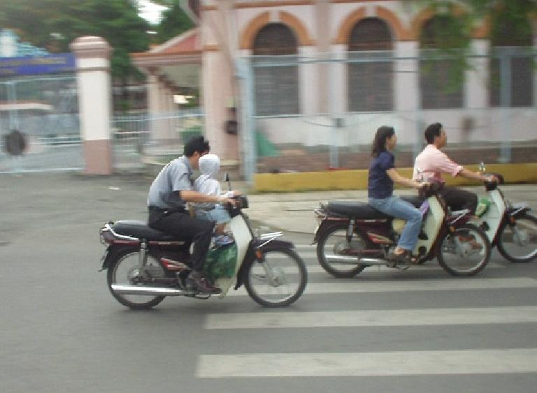 Motorbikers driving with babies in their lap is common in Vietnam!