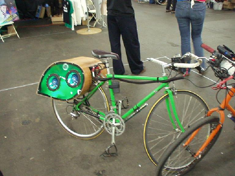 Check out this city bike with a huge boom box in the back and neon lights under the downtube.