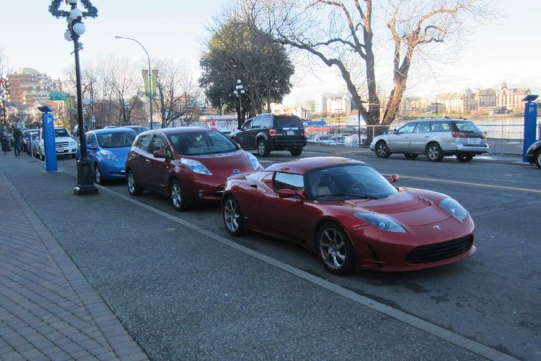 Tesla Roadster and two Nissan Leafs at an EV event near the State Legislature.