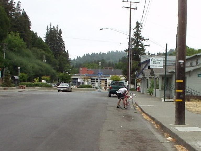 [Bike Mile 0, 1:57:xx elapsed] As if that wasn't bad enough, then I couldn't clip in to my pedals!  Here I am dismounting from my bike, trying to clean my cleats.  Wow, what an unsmooth transition! Photo: Sharon Schneckenberger.