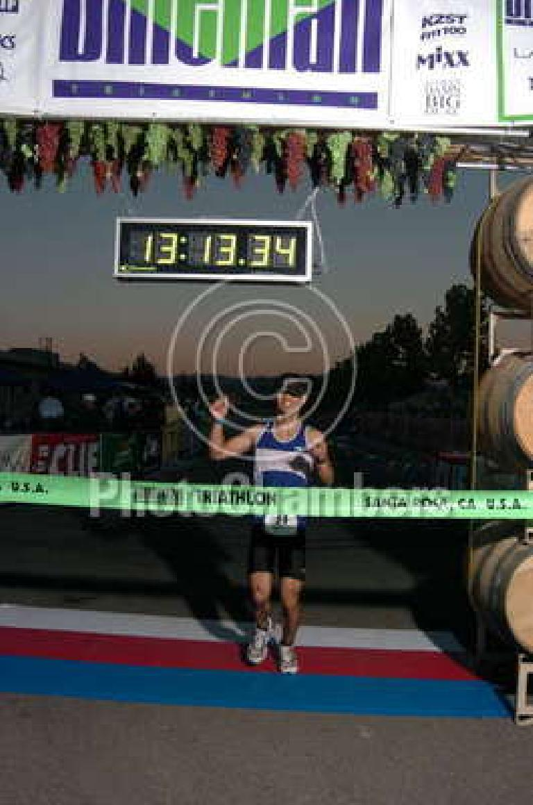 [Run Mile 26.2] This was the finish with some great announcers and supportive spectators!  My final time was 13:13:xx... an unlucky time? No. Photo: PhotoChambers.com.