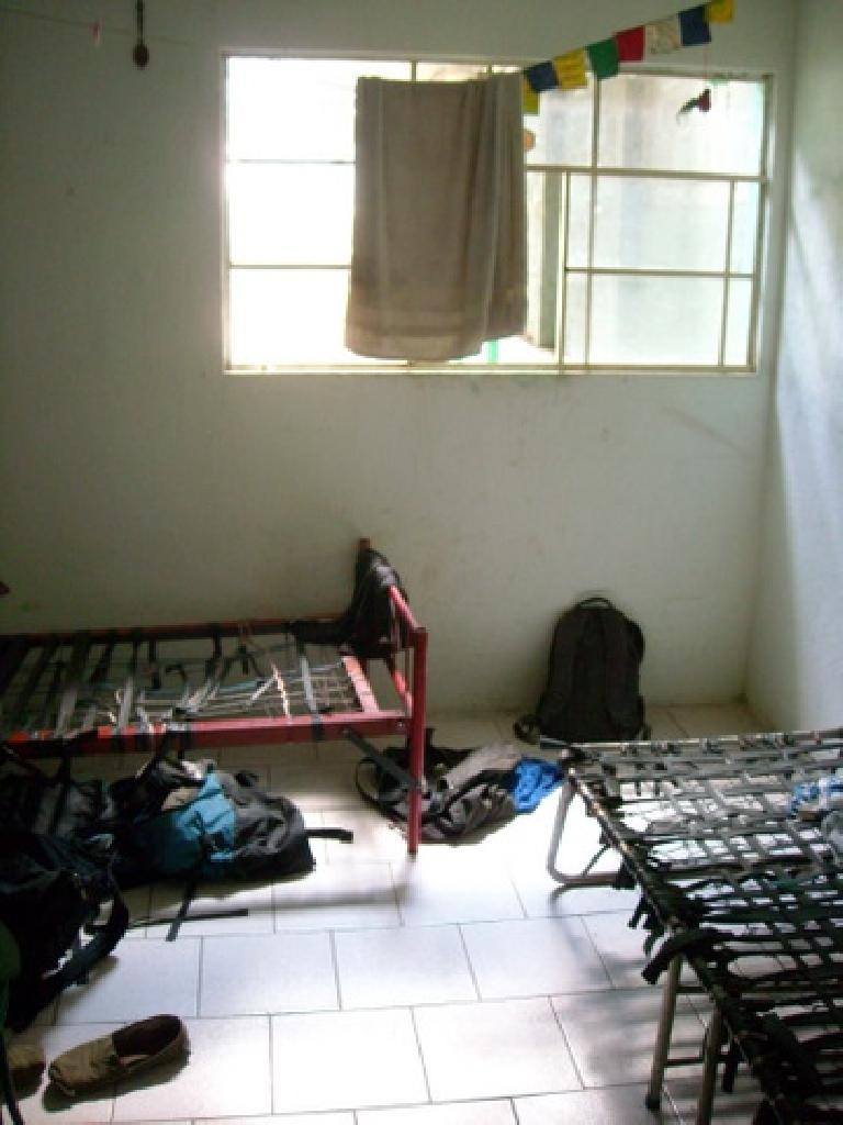 Sleeping quarters for the volunteers were not exactly the Hilton.  Note how these bed frames used recycled bicycle tubes as suspension. (December 26, 2010)