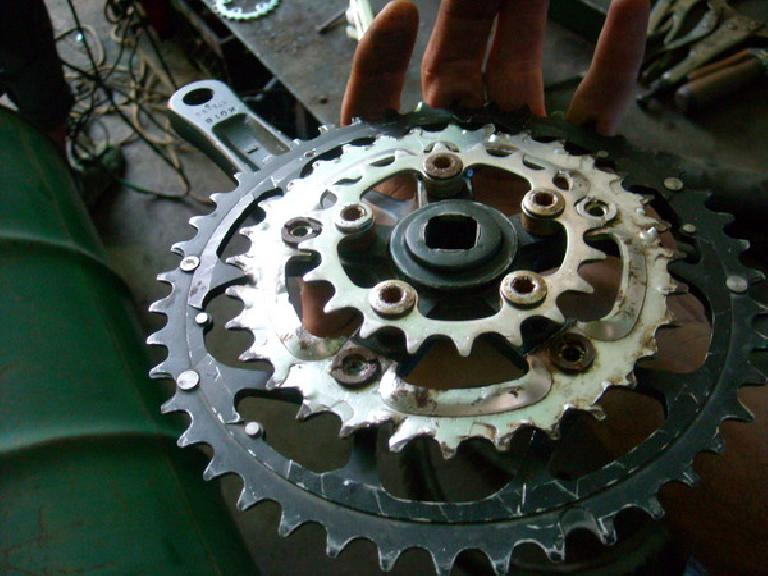 "Bruce's managed to ""create"" this crankset.  Note how he had to cut off the spider arms on the middle chainring to get it to work. (December 29, 2010)"