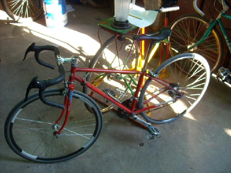 A customer who came in to buy parts created this bike.  He had a friend reweld frame tubes to give it compact geometry. Also cut out the saddle and removed every 8th spoke from the wheel. (December 30, 2010)