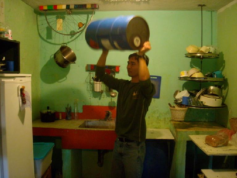 Felix Wong rinsing out a methanol tank that was to be used as an interior drum for the new bici-frijole machine. (December 31, 2010)