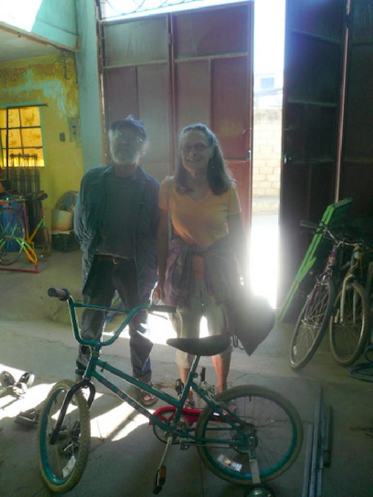 Two folks from Antigua who came in to purchase the kids bike, shown, as a gift for some people they were visiting. (January 4, 2011)