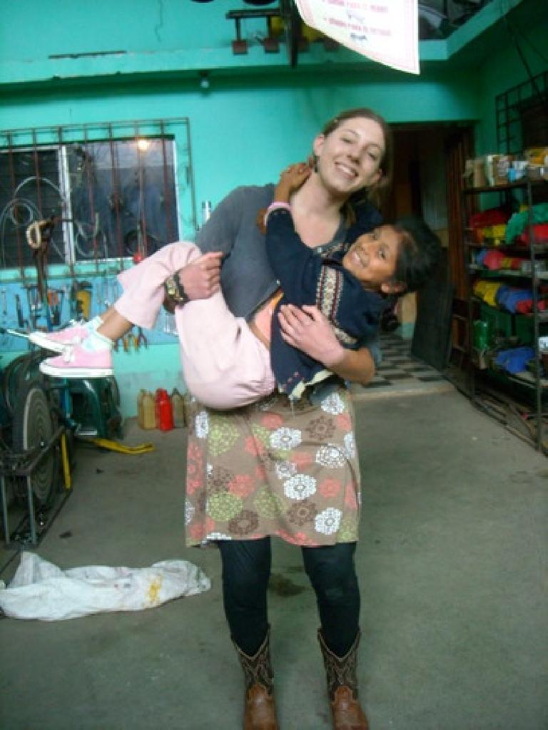 Michelle and Kimberley, one of the super affectionate local children. (December 26, 2010)