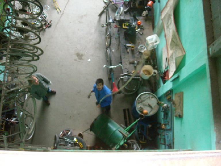 The experimental bicilavadora (bicycle washing machine) being lowered down to the shop floor. (December 26, 2010)