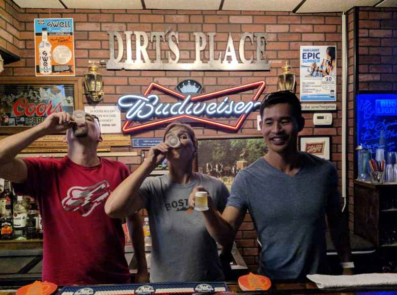 Manuel, Mel, and Felix drinking a mini-beer at Dirt's Place in Shenandoah, Iowa.
