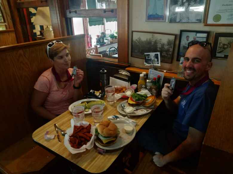 Mel and Manuel eating lunch at the Depot after the 2019 Wabash Trace Trail Marathon.