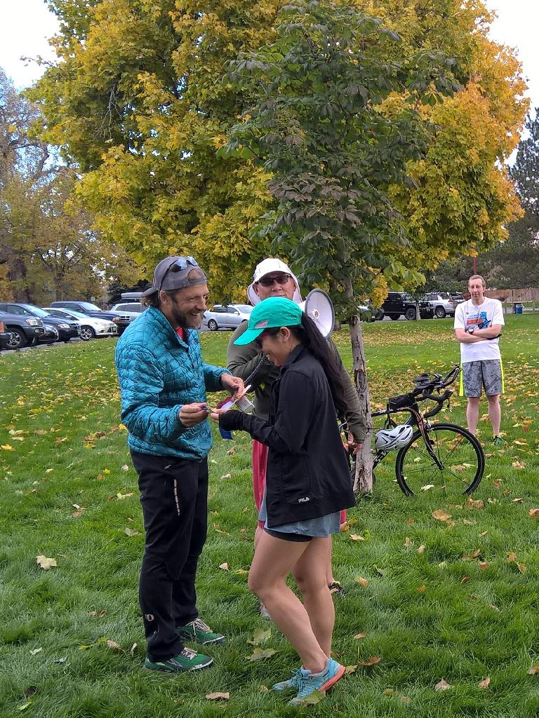 Nick awards the first place ribbon to Vanessa at the 2015 Warren Park 5k Tortoise & Hare race.