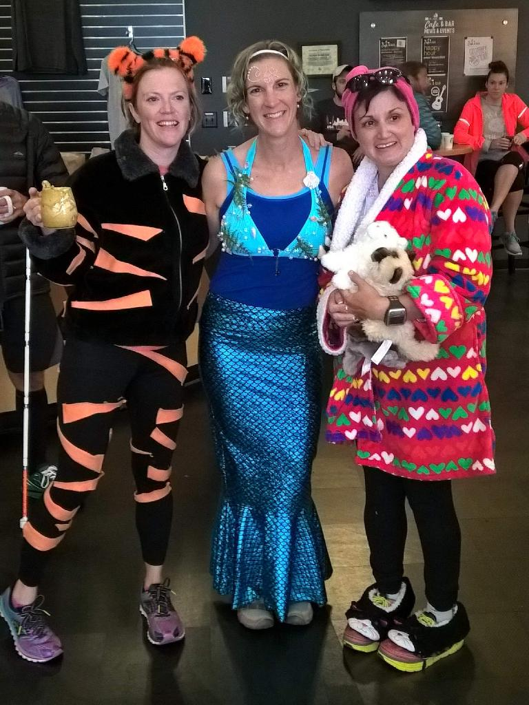 Three great costumes at breakfast after the Nick awards the first place ribbon to Vanessa at the 2015 Warren Park 5k Tortoise & Hare race: Tigger, a mermaid, and a crazy cat woman.