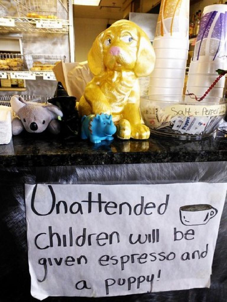 """Sign at Rocky Mountain Bagels: """"Unattended children will be given espresso and a puppy!"""""""