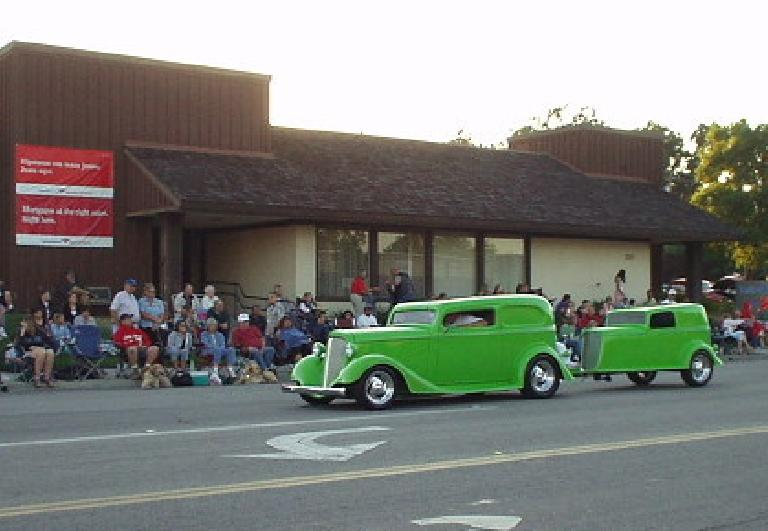 "We went to Paso Robles on Friday night to watch the West Coast Cruise.  Here's a green hot rod with a ""baby hot rod"" trailer in tow."