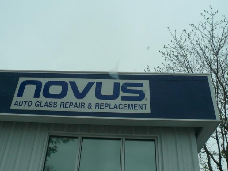 sign on building saying Novus Auto Glass Repair & Replacement