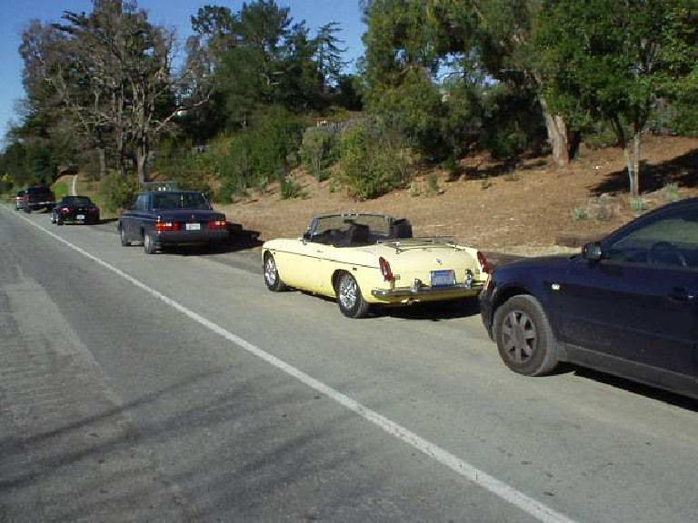 Speaking of sports cars, here's Goldie, back in the land we used to roam (Portola Valley) back in our Stanford days. You can sort of see Adrian's black Z3 in there too. Can't wait 'til our next hike!