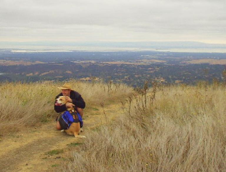 Adrian and Bue pose for the camera with Palo Alto and the SF Bay in the background.
