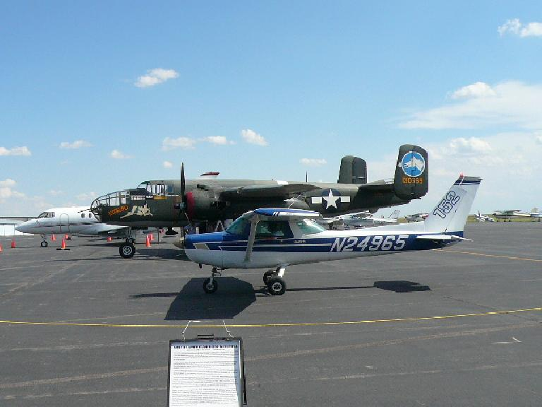 Private plane drives by a B-25.