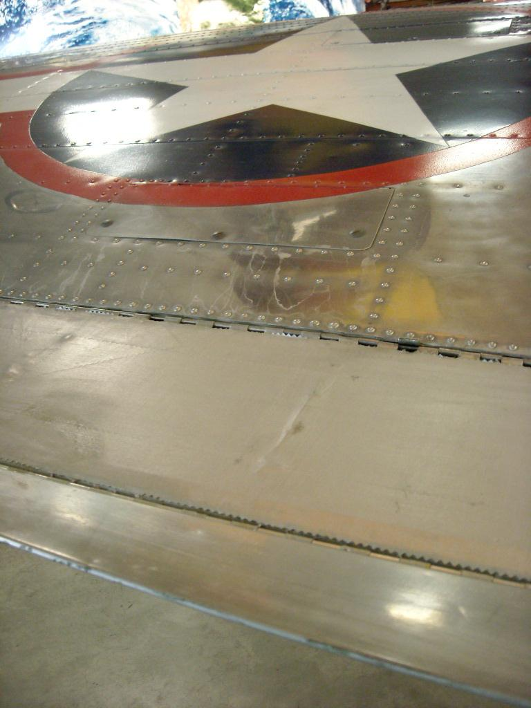 Several WWI-era planes used fabric tape for the wing tips, which was light weight.