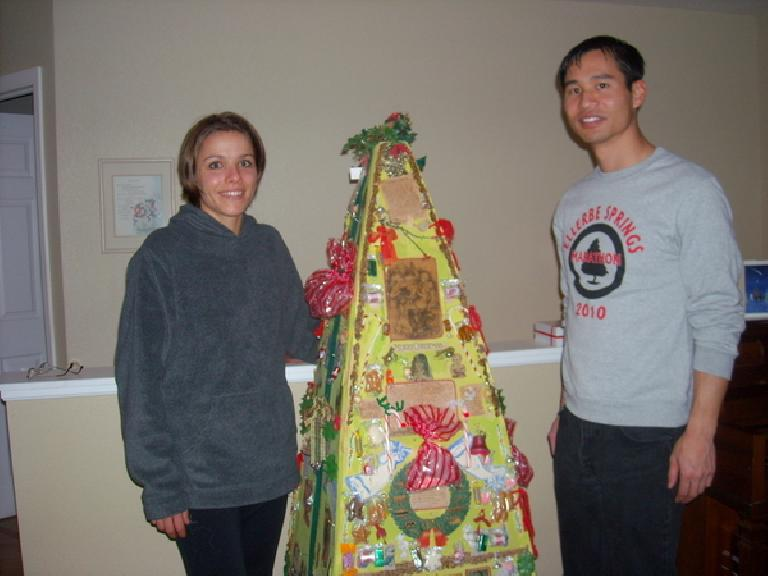 Leah and Felix Wong by Dee's whatnot tree, which she created in 1973.