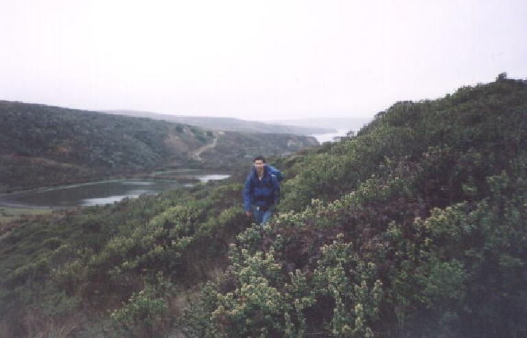 [Point Reyes, Nov 2001] Felix Wong charging dwn the trail in crazy-rain weather. (November 11, 2001)