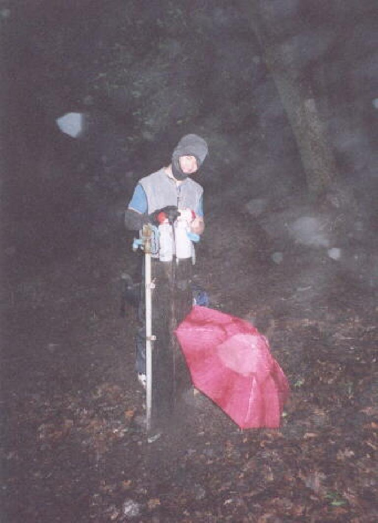 [Ohlone Wilderness Trail, Jan 2002] At camp, purifying some water from a faucet and bundled up with my fleece hat & sleeveless jacket, and... one arm warmer. Photo: Sarah Toas. (January 26, 2002)