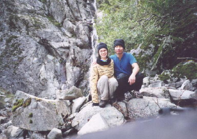 [Ohlone Wilderness Trail, Jan 2002] Sarah and Felix Wong in front of the falls. Photo: Sarah Toas. (January 27, 2001)