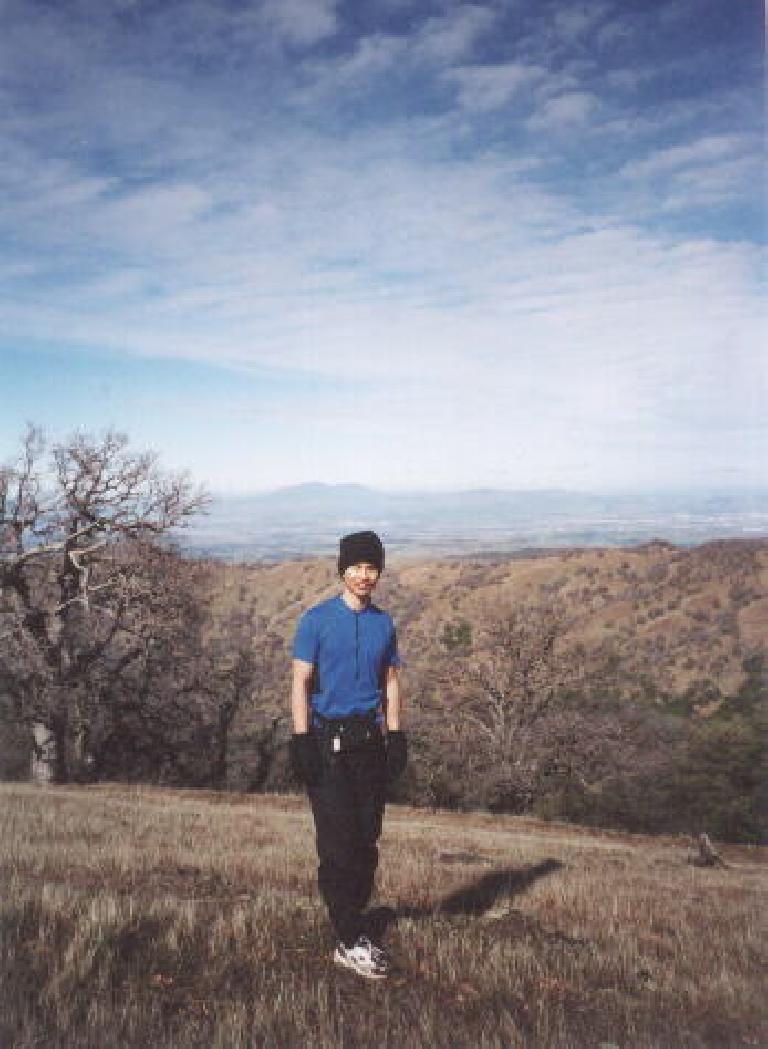 [Ohlone Wilderness Trail, Jan 2002] Felix Wong on top of Rose Peak with Mt. Diablo in the background. Photo: Sarah Toas. (January 27, 2001)