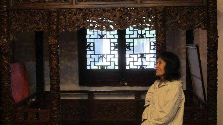 My mom inside the Xue Family Garden mansion.