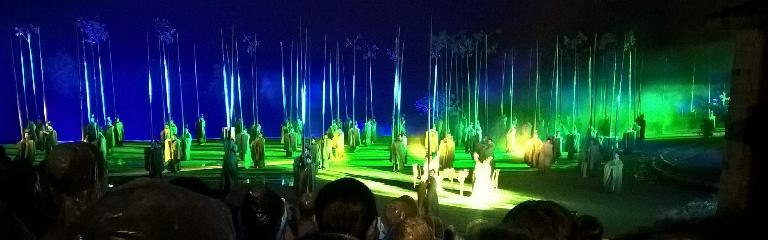 The outdoor theatrical production about tea while it was raining in Wuyishan, China. It was produced by the same person who helped put on the elaborate production at the 2008 Beijing Olympics.