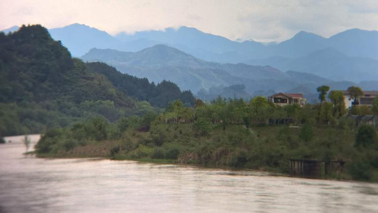 Mountains beyond Chongyang Brook in Wuyishan, China.