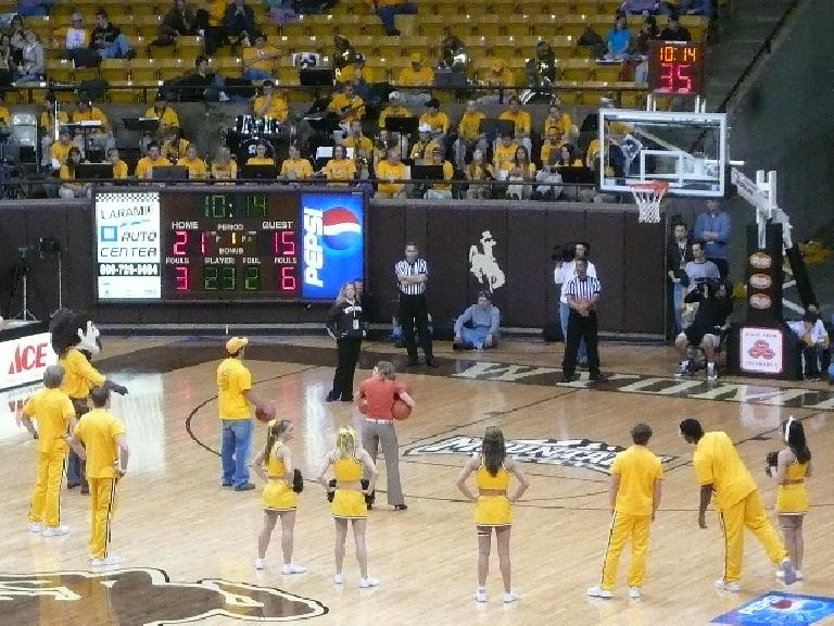 This was a three-pointer contest during a time-out.  The guy shooting the ball won a free flight by making three of them.