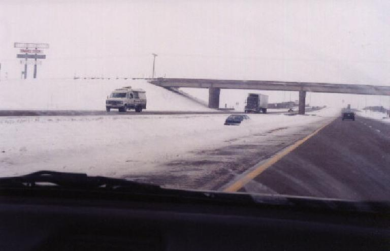 One of the many cars buried under snow along I-80. (January 30, 2000)