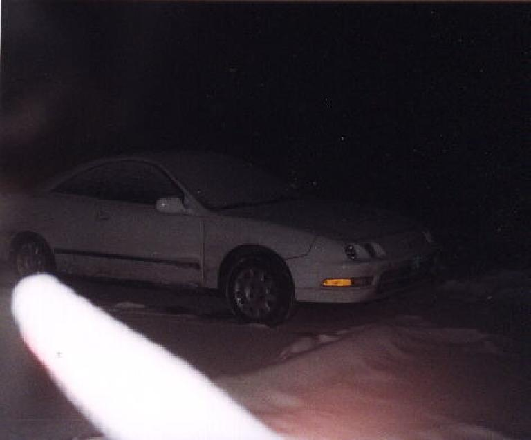 PC, Esther's trusty Acura Integra, at night in Nebraska (or is it Wyoming?). (January 30, 2000)