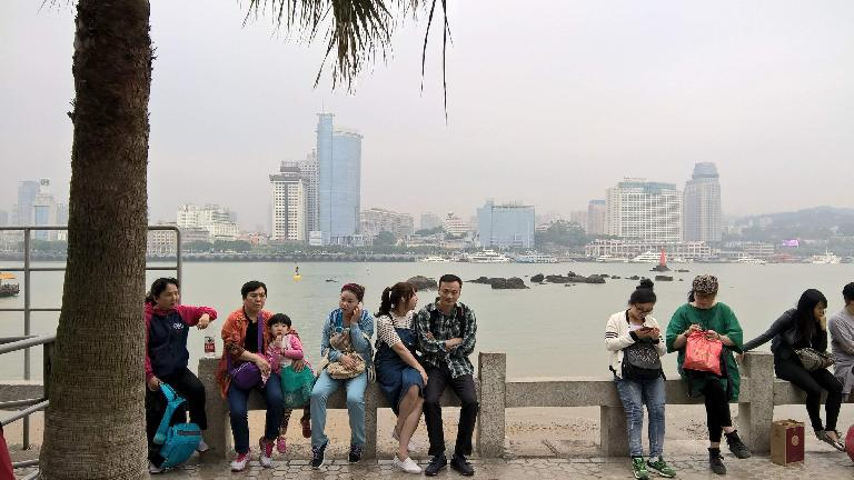 Folks by the harbor of the island of Gulangyu, with Xiamen in the background. (April 20, 2016)