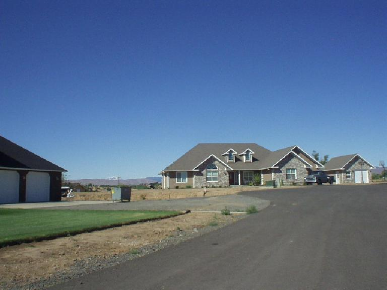 ... to large homes on a hill with views of Mt. Adams.