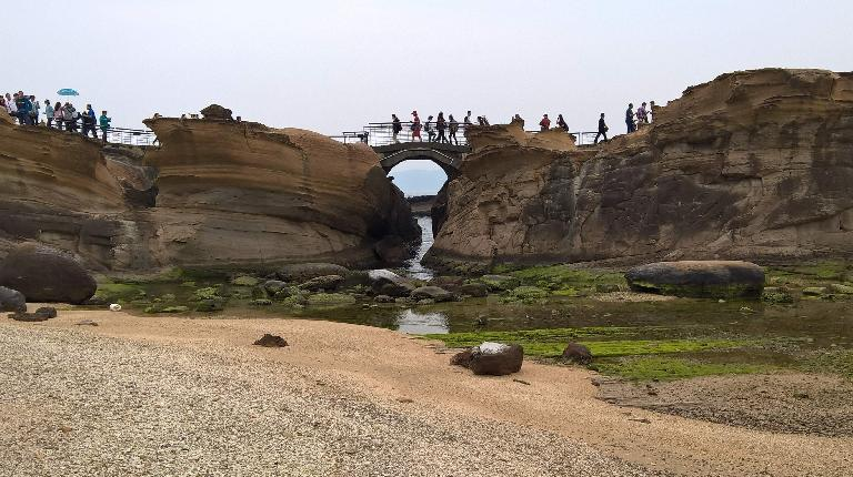 Pedestrian bridge over a creek in Yehliu Geopark.
