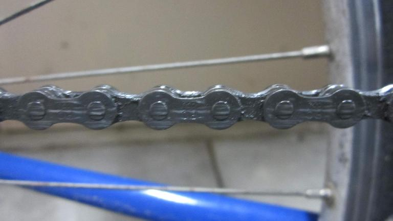 My Gitane's chain after using the Z Chain Oiler, before wiping with a rag.