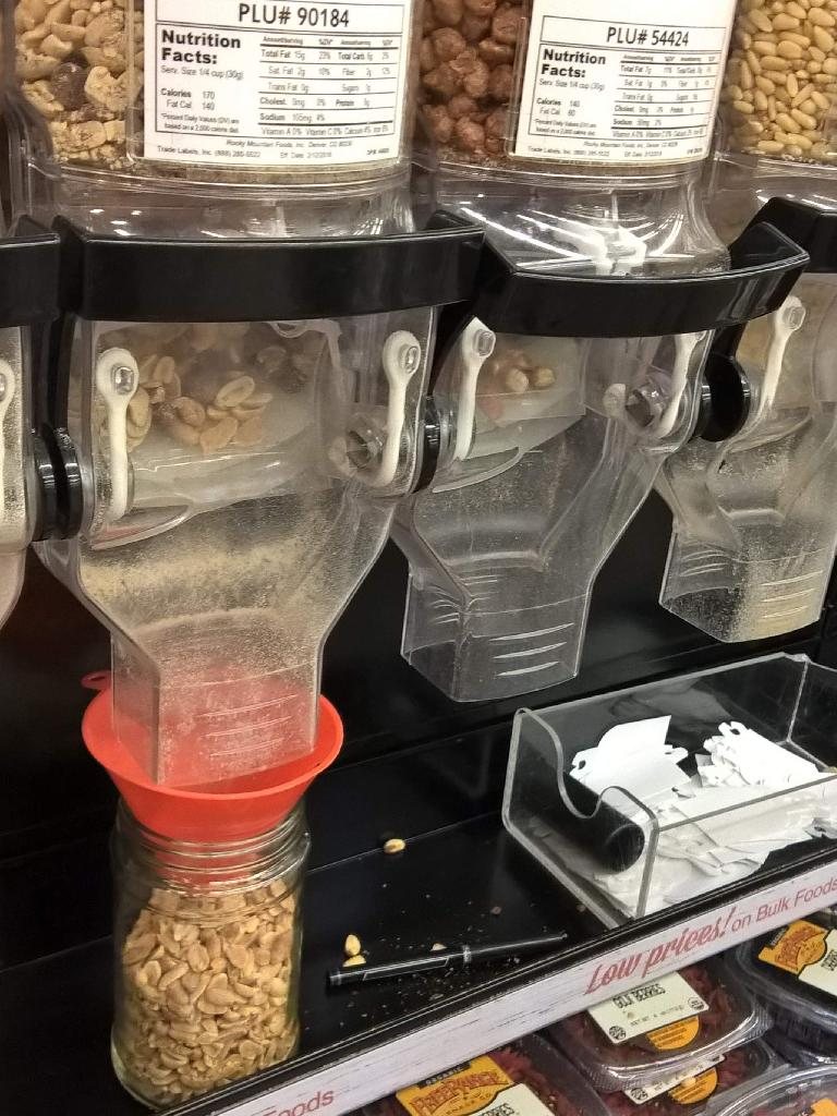 You can fill your own jars in the bulk sections of King Soopers. In this photo, I used an orange funnel I brought, but the funnel is unnecessary and I no longer bring one.
